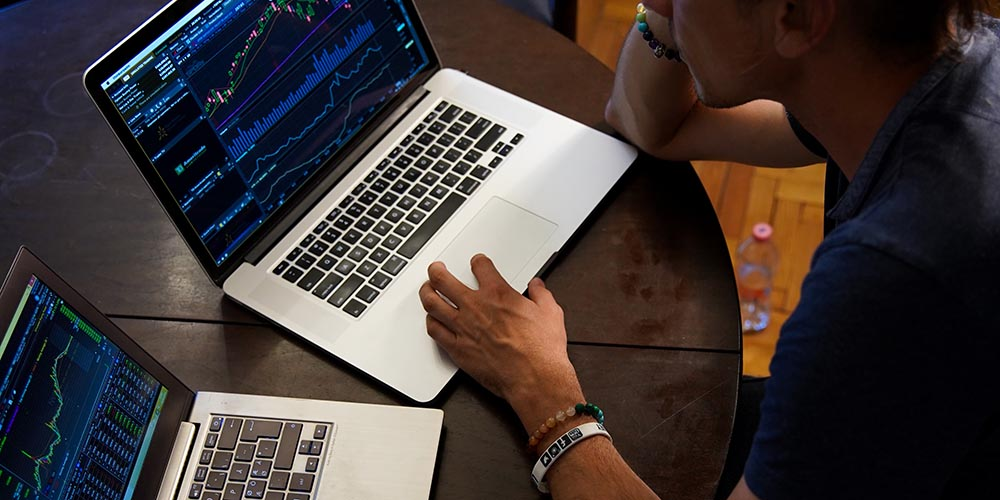 Day Trader working on charts